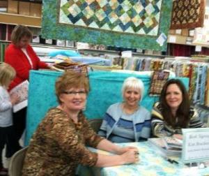 Background note: the little quilter consulting her new book